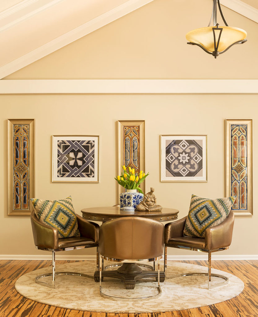 Elegant dining room seating with leather chairs, throw pillows and vaulted ceiling