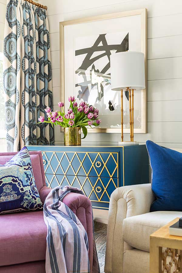 Blue dresser in purple living room