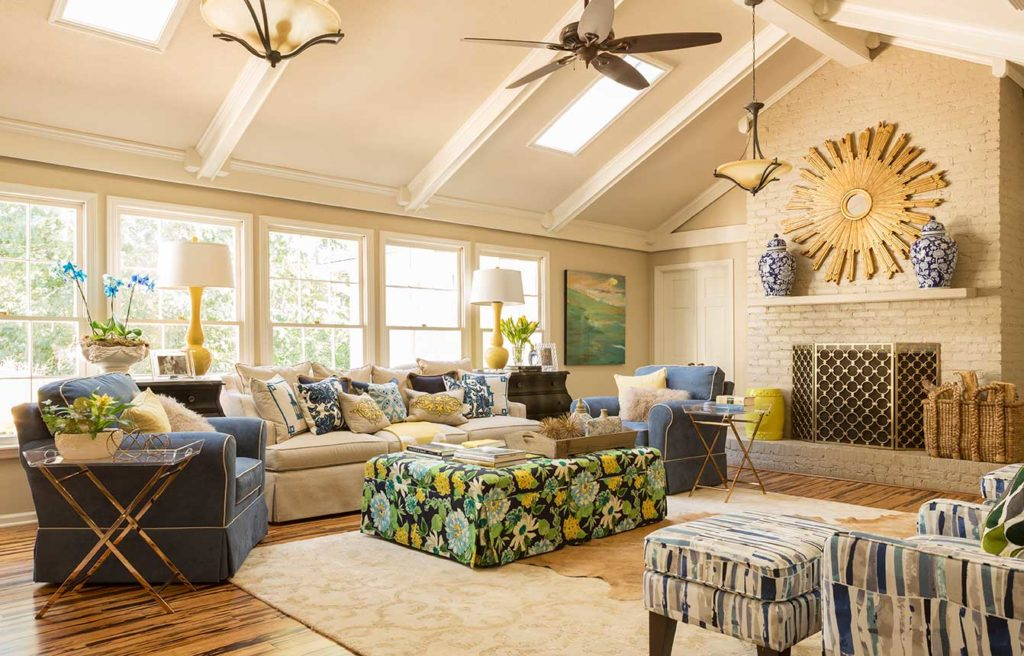 Large, open living space with multiple mixed patterns in blue, green and yellow
