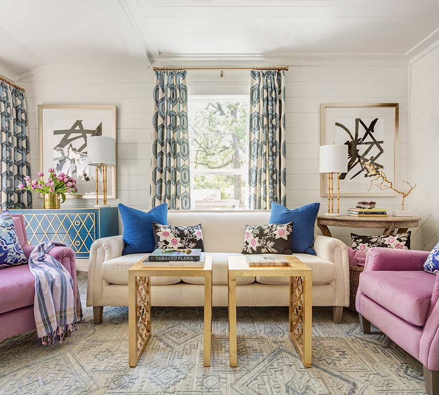 Living room with purple and navy accents and custom artwork