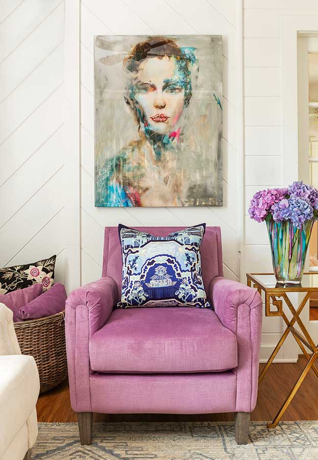 Purple sitting room with soft purple chair, throw pillow and custom painting of a woman